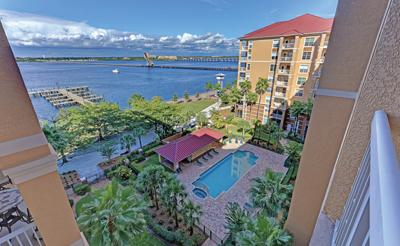 River Dance Condominium balcony and pool